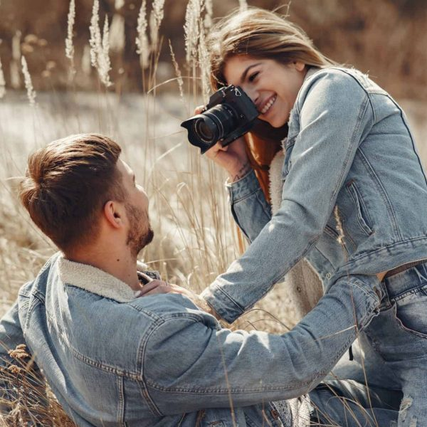 cute-couple-in-a-jeans-clothes-in-a-spring-field.jpg